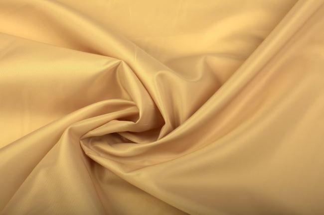 Polyesterová podšívka ve zlatavé barvě 0160/592